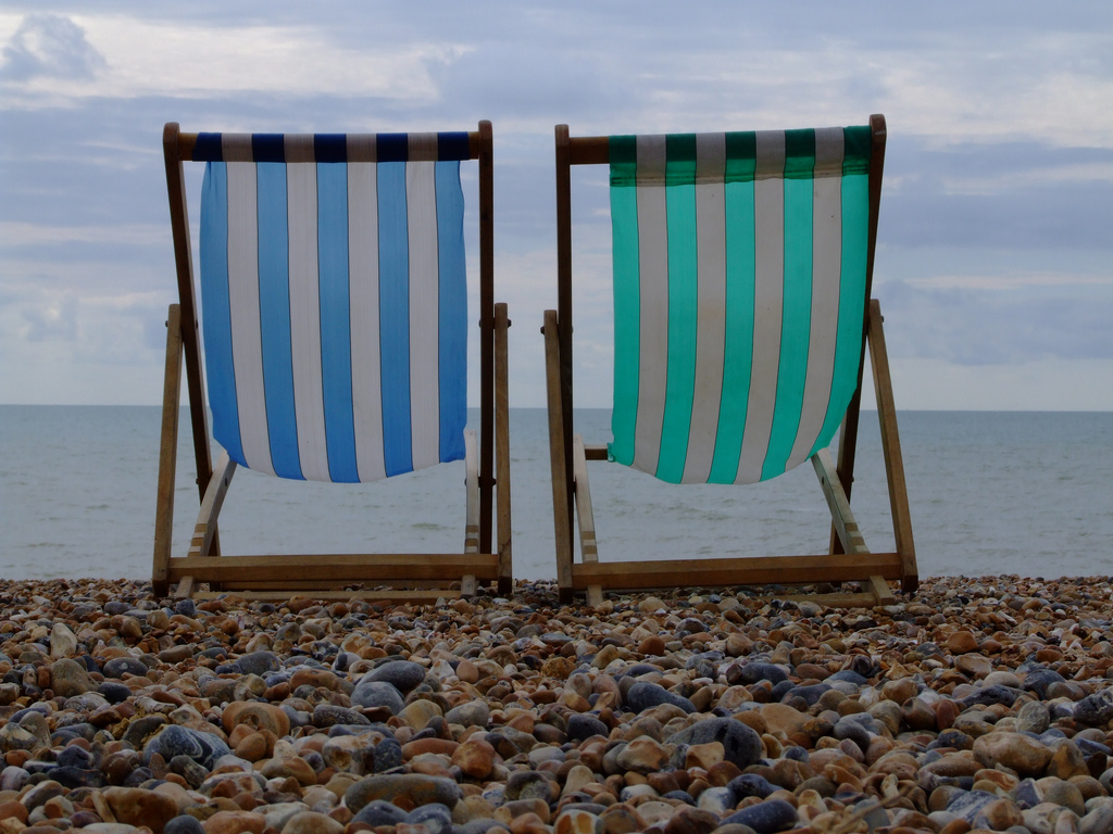 old deck chairs on brighton pebble beach