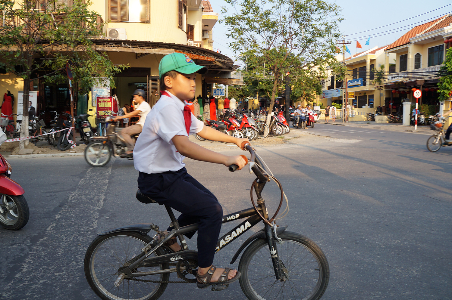 Hoi at school boy on bike